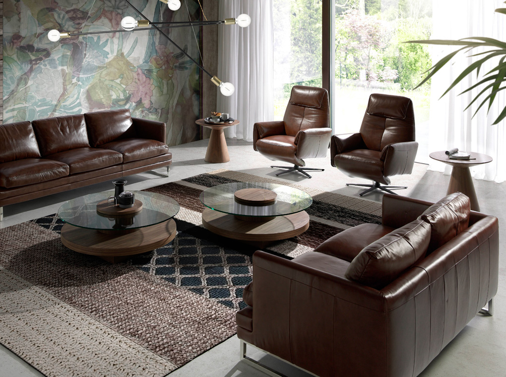 2-seat sofa upholstered in leather with stainless steel legs