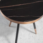 Round corner table in black porcelain marble and steel with a bronze-colored chrome bath.