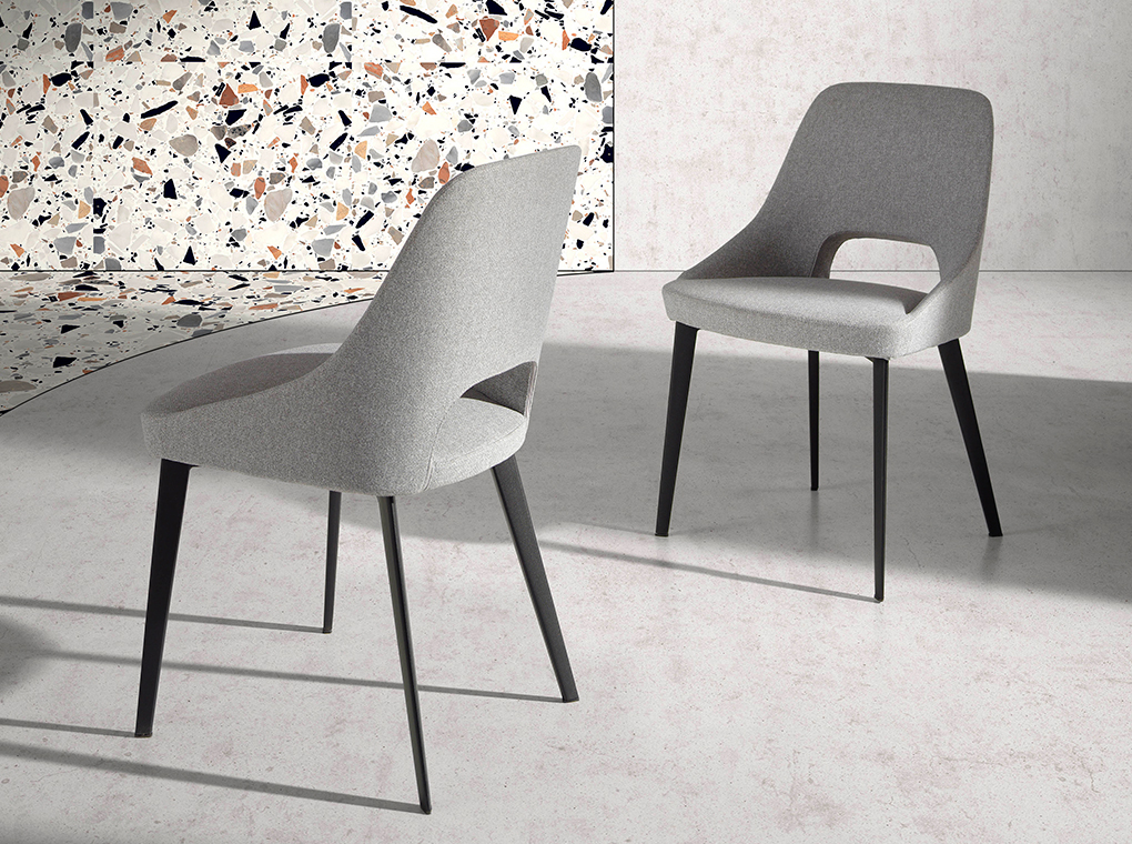 Fabric upholstered chair with black steel legs