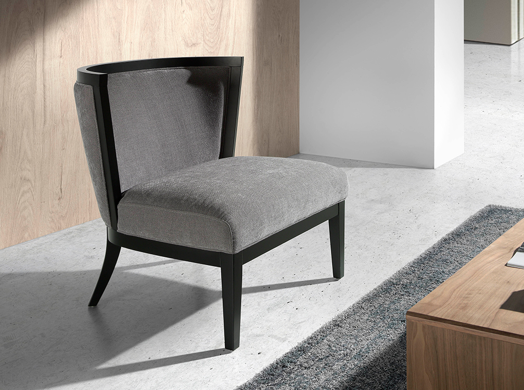 Upholstered armchair with wengue wood frame.