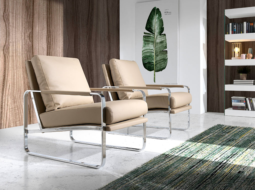 Armchair upholstered in leatherette and chrome steel legs