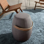 Puff upholstered in gray fabric