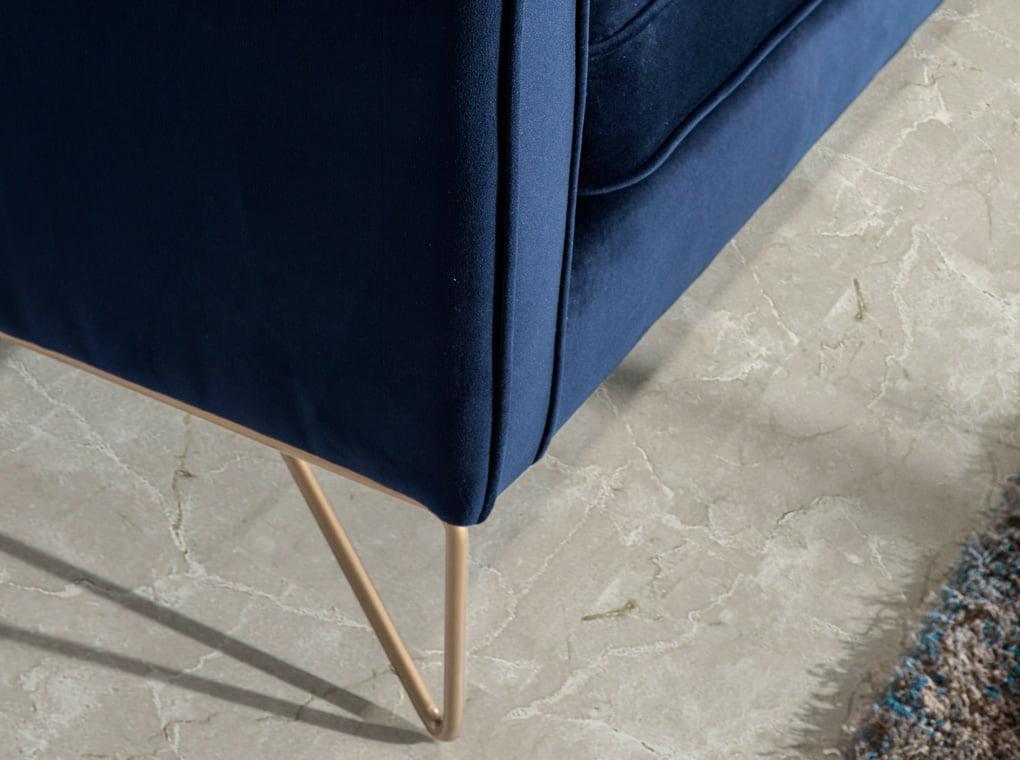 Armchair with stainless steel legs chromed in gold upholstered in velvet effect fabric
