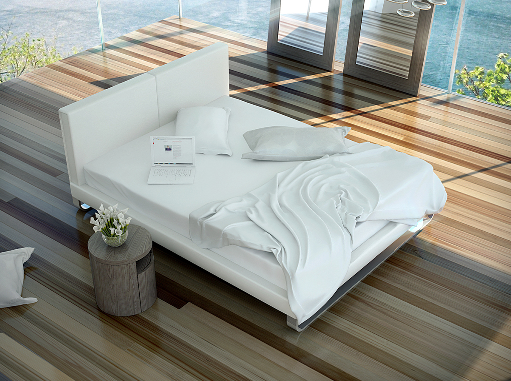 Bed upholstered in leatherette with polished steel legs
