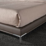 Upholstered bed with stainless steel legs
