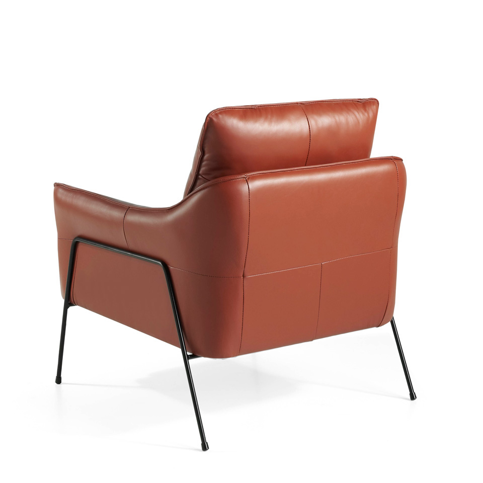 Armchair upholstered in cowhide leather