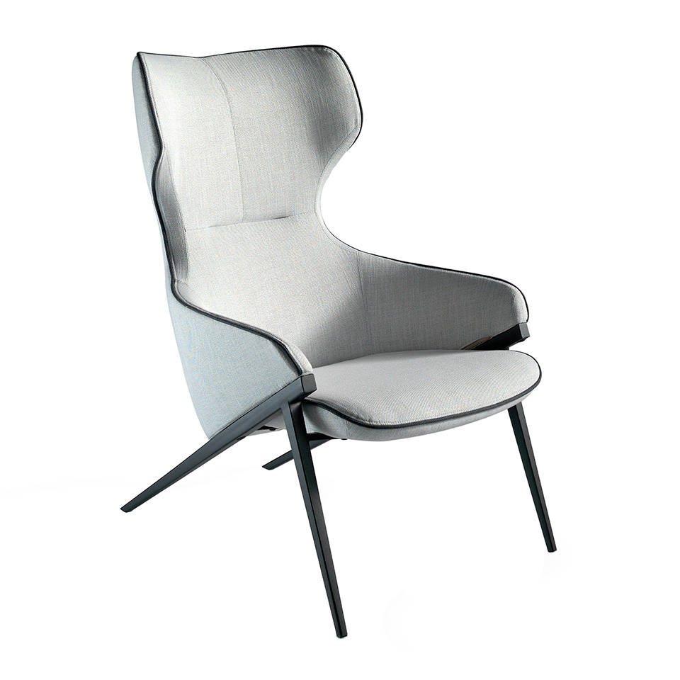 Armchair upholstered in fabric with black steel trim...