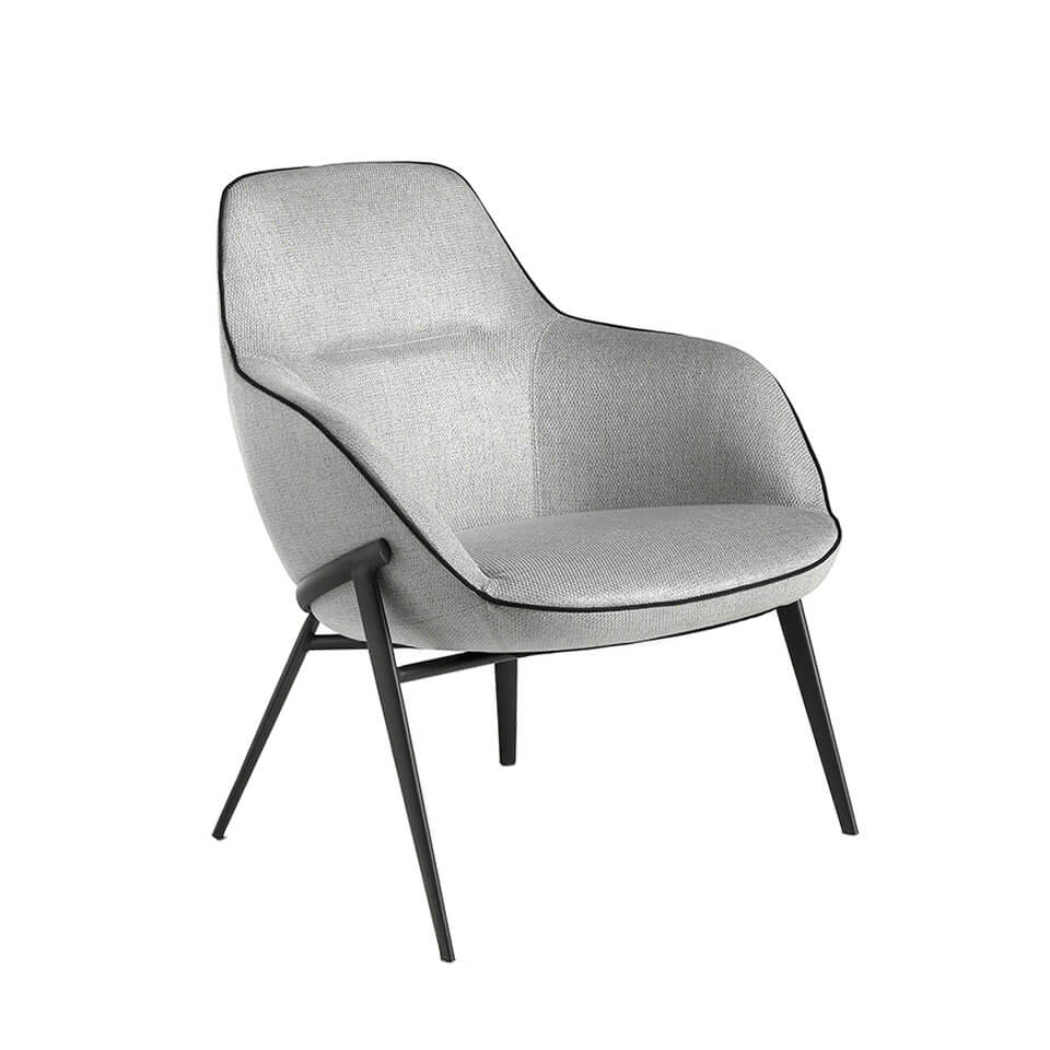 Armchair upholstered in fabric with steel legs