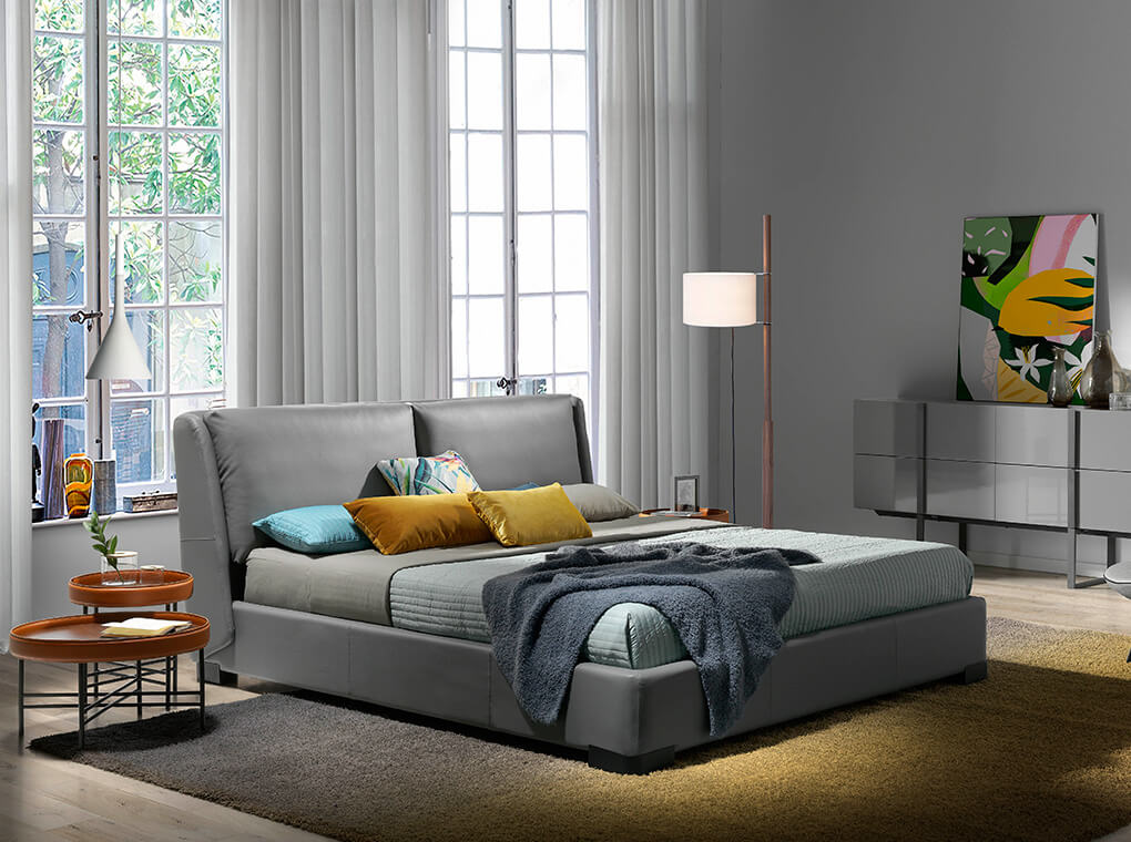 King size Bed upholstered with dark grey painted steel legs