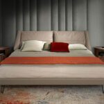 King size bed upholstered in leatherette with black painted steel legs