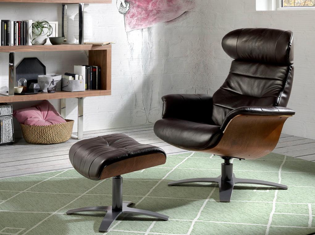 Swivel leather upholstered ottoman
