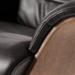 Swivel relax armchair upholstered in leather
