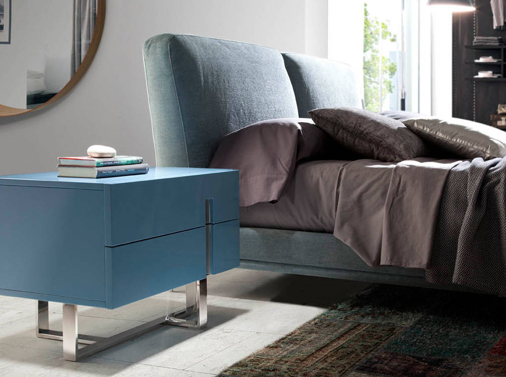 Upholstered bed with stainless steel legs.