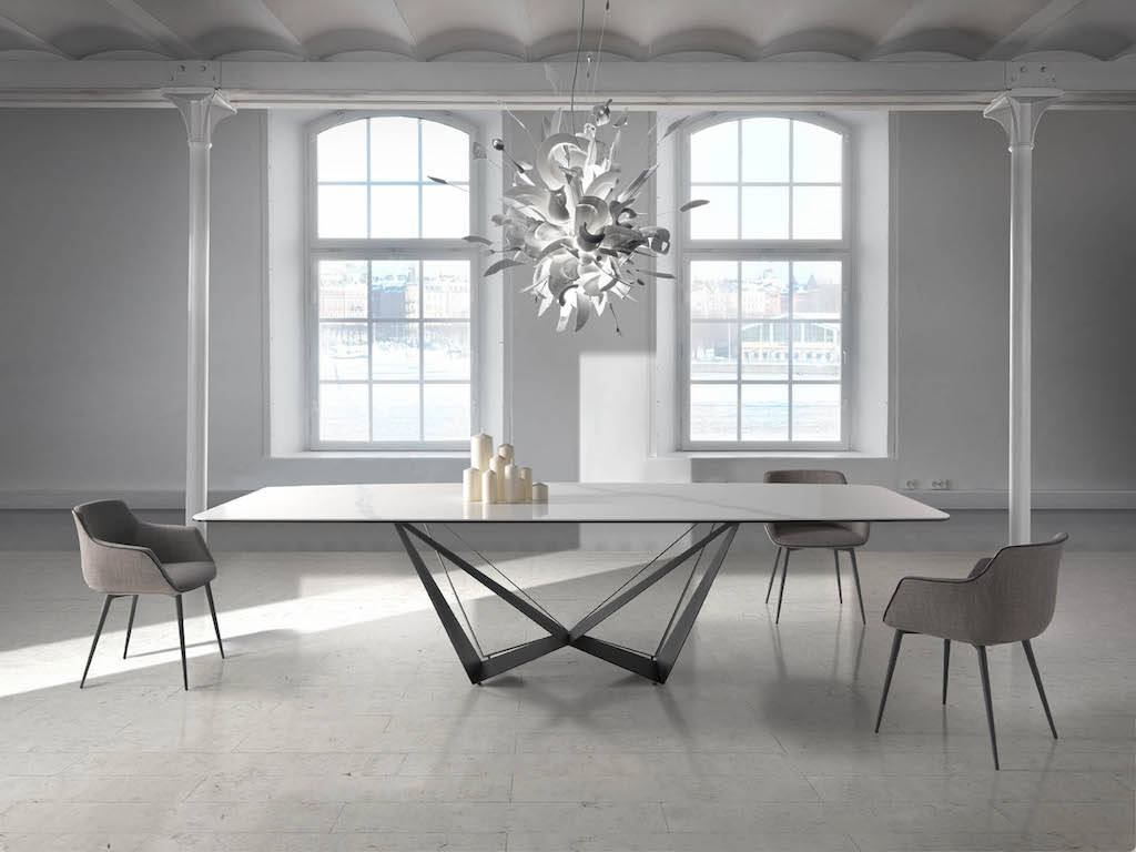 Rectangular dining table with steel structure and ceramic marble cover.