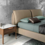 Upholstered synthetic leather bed