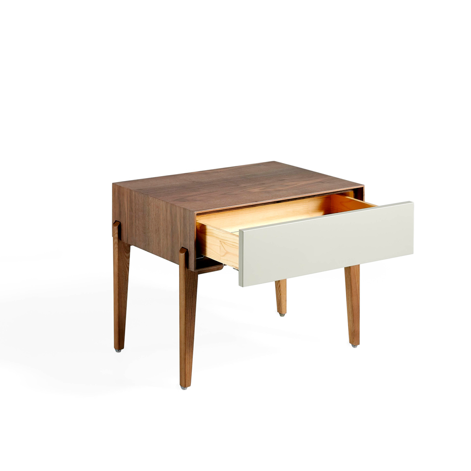 Bedside table with solid wooden legs and a Walnut veneer structure