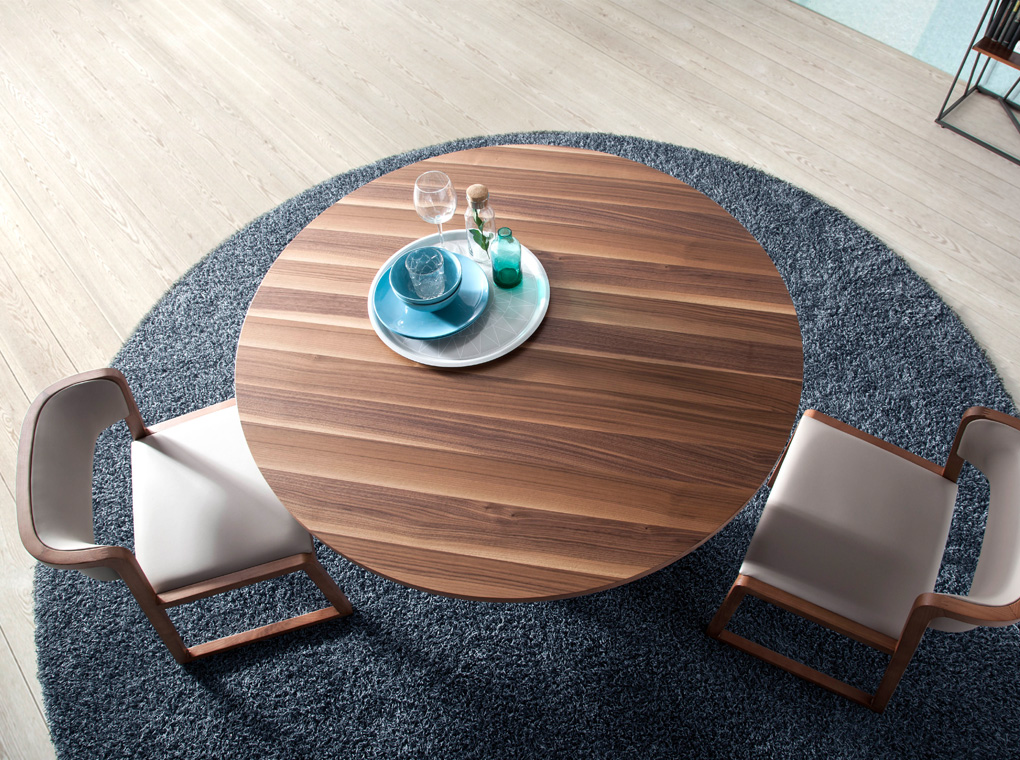 Dining table with round walnut top and epoxy painted steel base