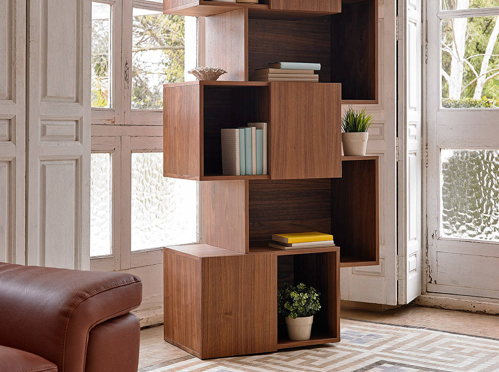 Bookshelves in walnut veneered wood.