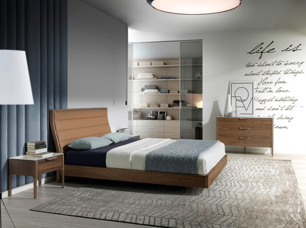 Walnut-veneered wood bed