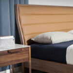 Bed upholstered in leatherette and Walnut wood