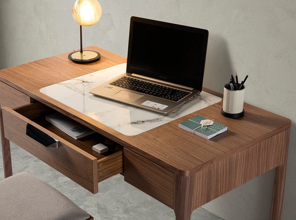 Office desk with drawer made of walnut-veneered wood