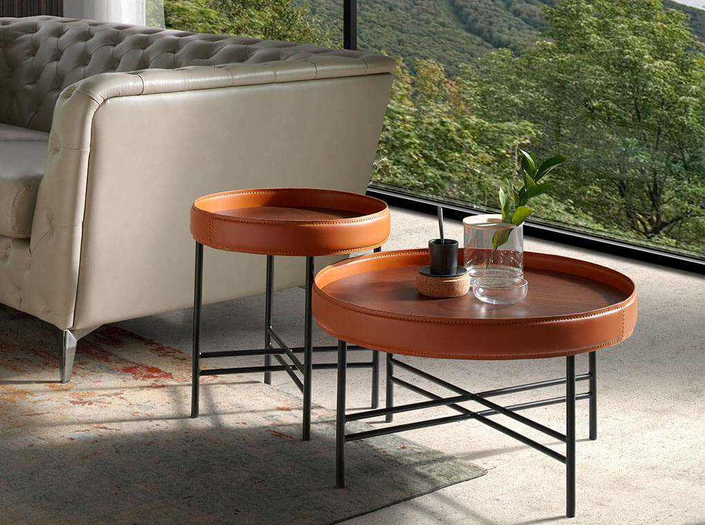 Coffee table in walnut veneer with circular ring upholstered
