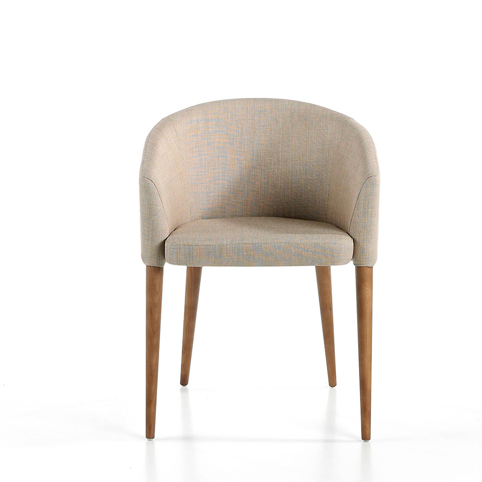 Upholstered armchair with legs in walnut colour.