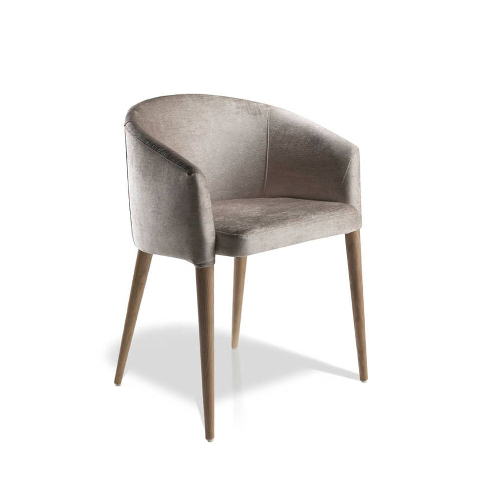 Upholstered armchair with walnut legs.
