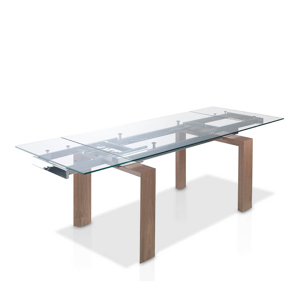 Extendible dining table with tempered glass top and walnut veneered wood legs.