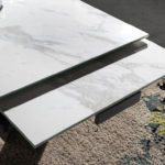 Extendable porcelain and black steel dining table