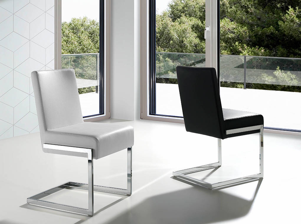 Upholstered chair with stainless steel frame.