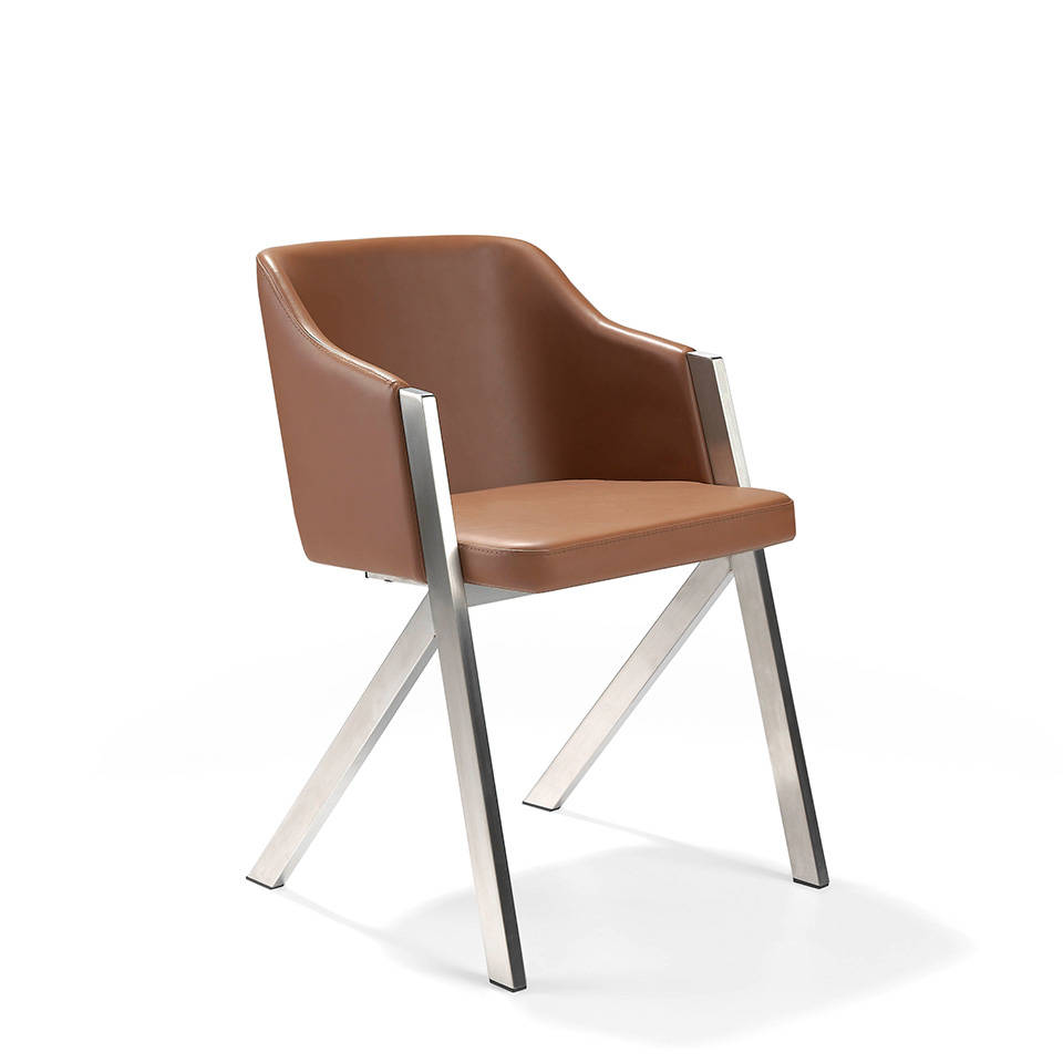 Chair upholstered in leatherette with polished steel frame