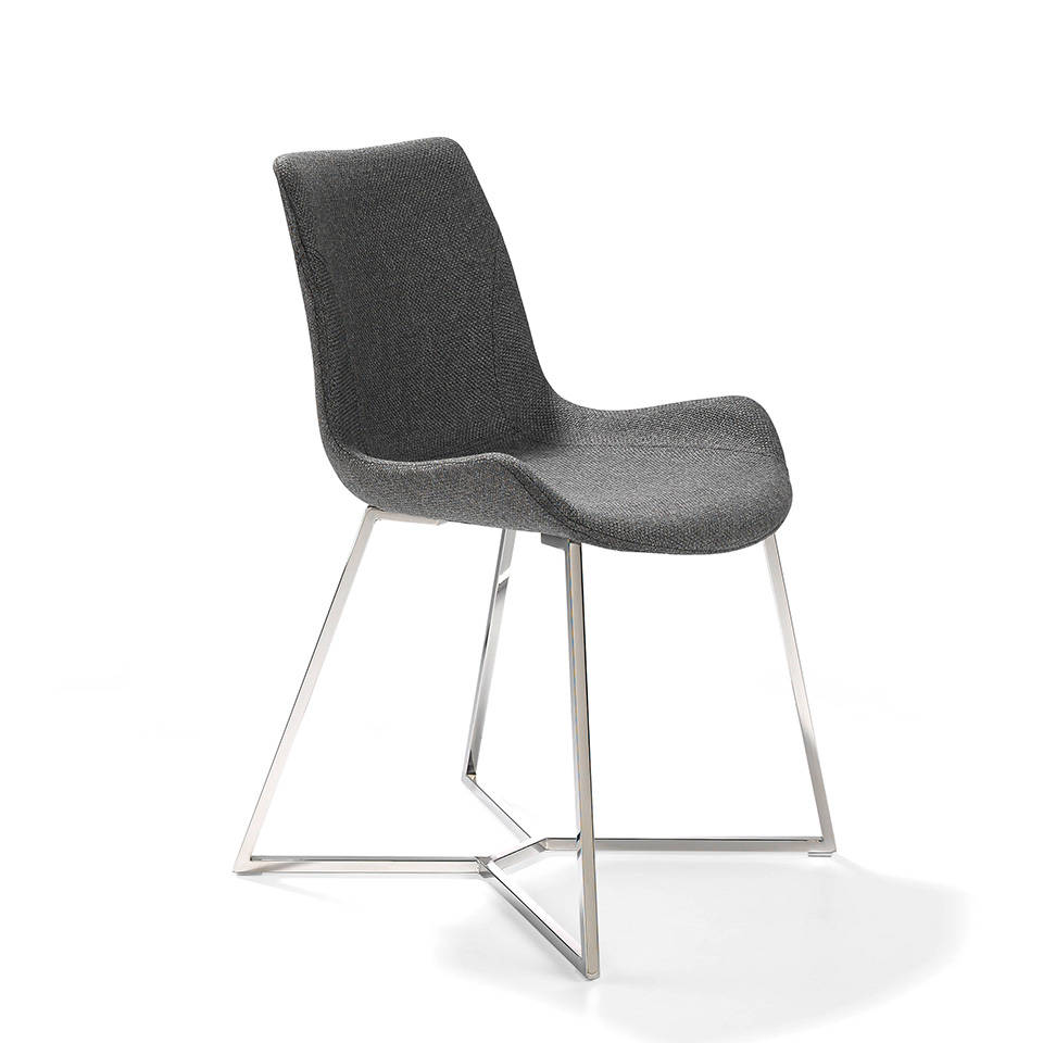Swivel chair with stainless steel legs and seat upholstered in fabric