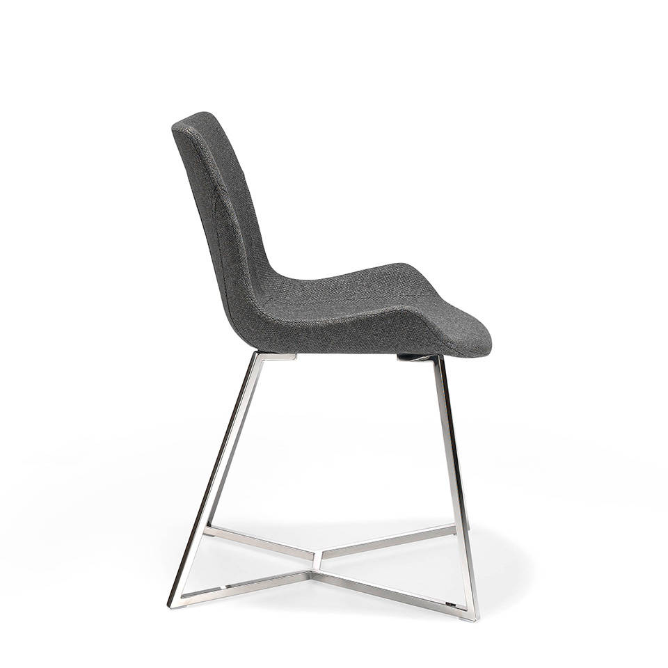 Chair with stainless steel legs and seat upholstered in fabric