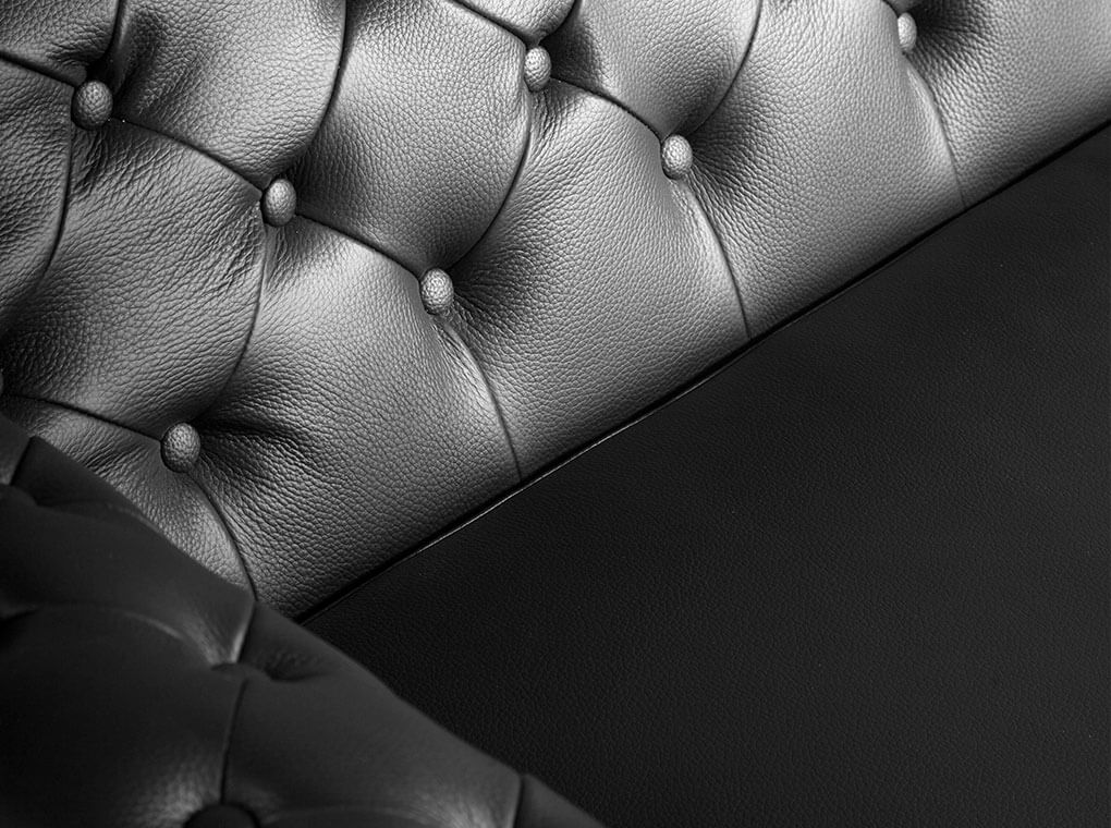2-seater sofa upholstered in leather with steel legs in grey epoxi