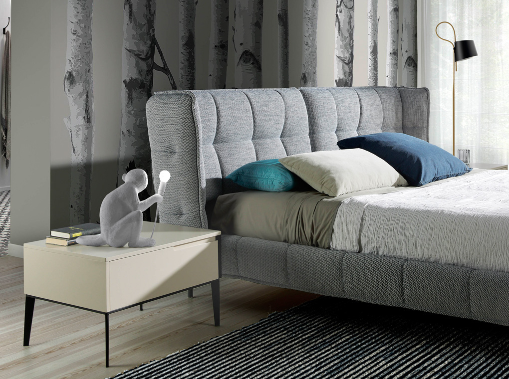 Bed upholstered in grey fabric