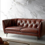 2-seater sofa upholstered in tufted leather
