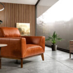 Armchair upholstered in leather with walnut-colored wooden legs