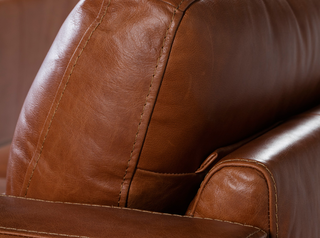 2-seater sofa upholstered in leather with Walnut wood legs