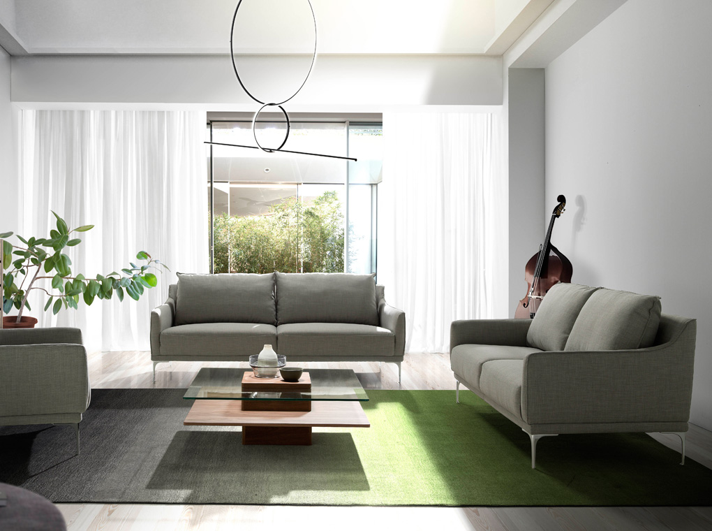 3-seater sofa upholstered in fabric with chromed steel legs