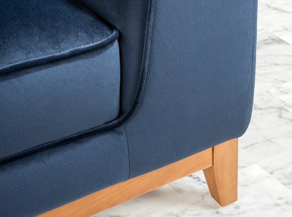 2-seater sofa upholstered in velvet with Walnut wood legs