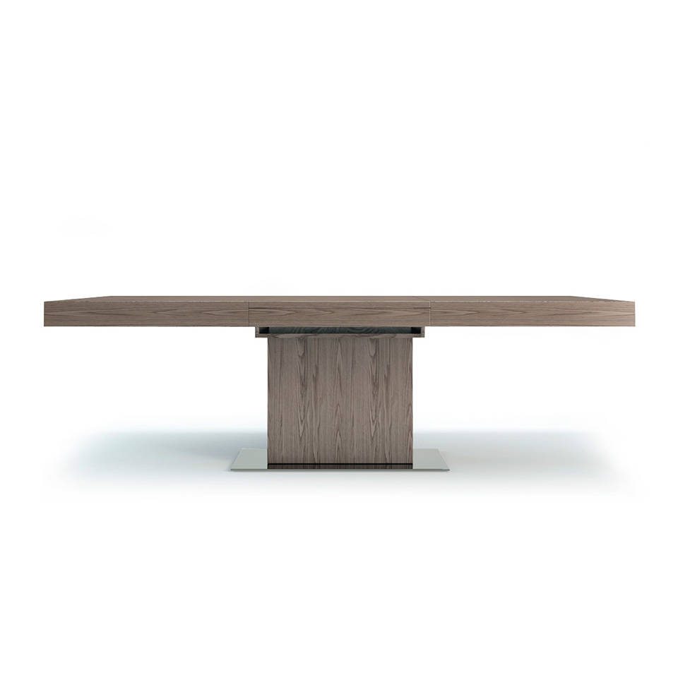 Rectangular extendible dining table in walnut veneered...