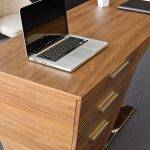 Office desk in walnut veneered wood.