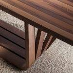 Dining table with walnut veneered wood base and tape