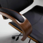 Office armchair upholstered in black leatherette