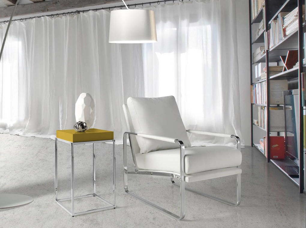 Upholstered armchair with stainless steel frame