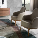 Armchair upholstered in leatherette and Walnut wood legs