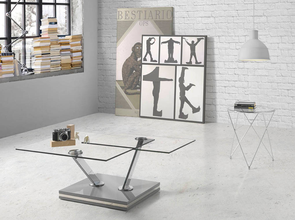 Corner table with tempered glass top and stainless steel base.