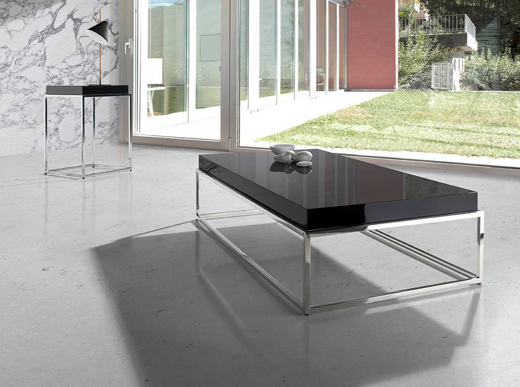 Coffee table with lacquered Mdf top and stainless steel base.