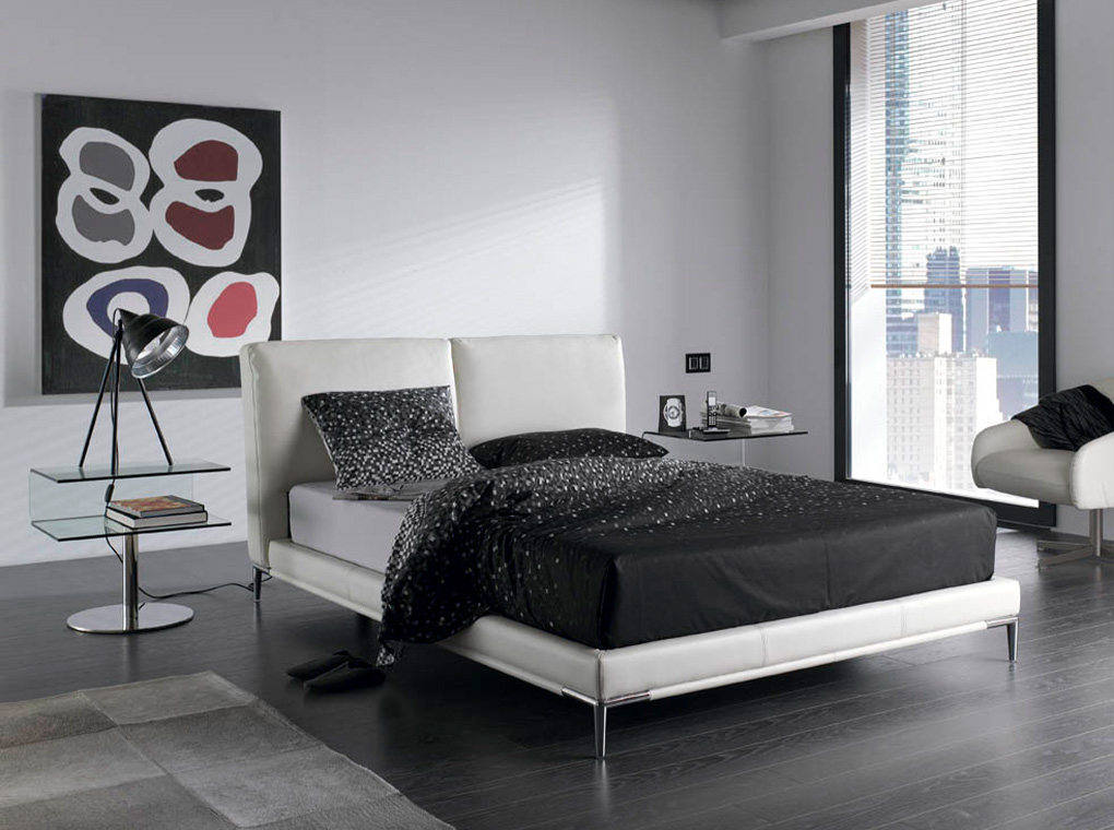Bed upholstered in leatherette with dark polished steel legs